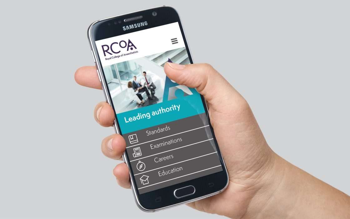 Phone displaying RCoA mobile website in a persons hand.