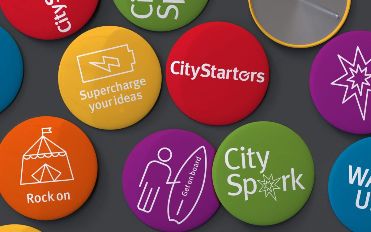 A collection City Starters badges.