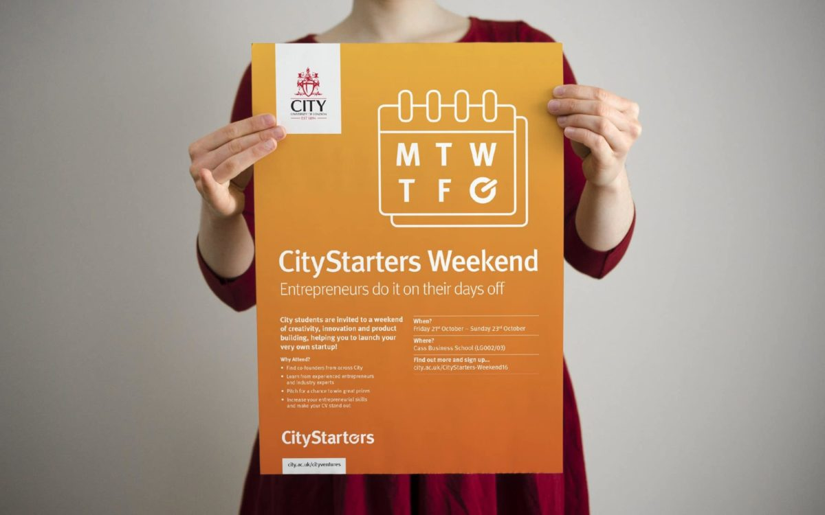 Close-up of CityStarters Weekend poster being held by a woman.