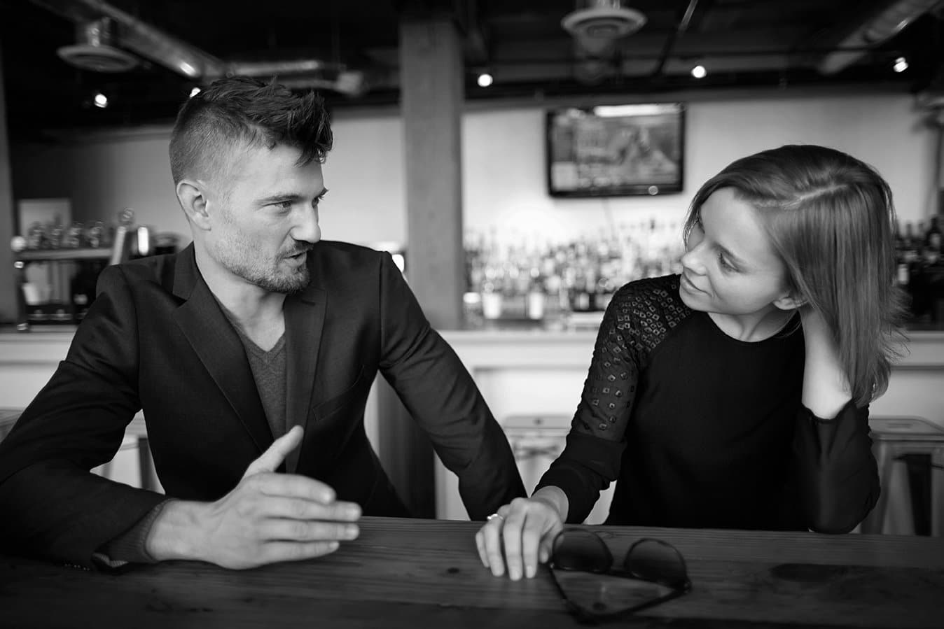Couple having conversation in a restaurant.