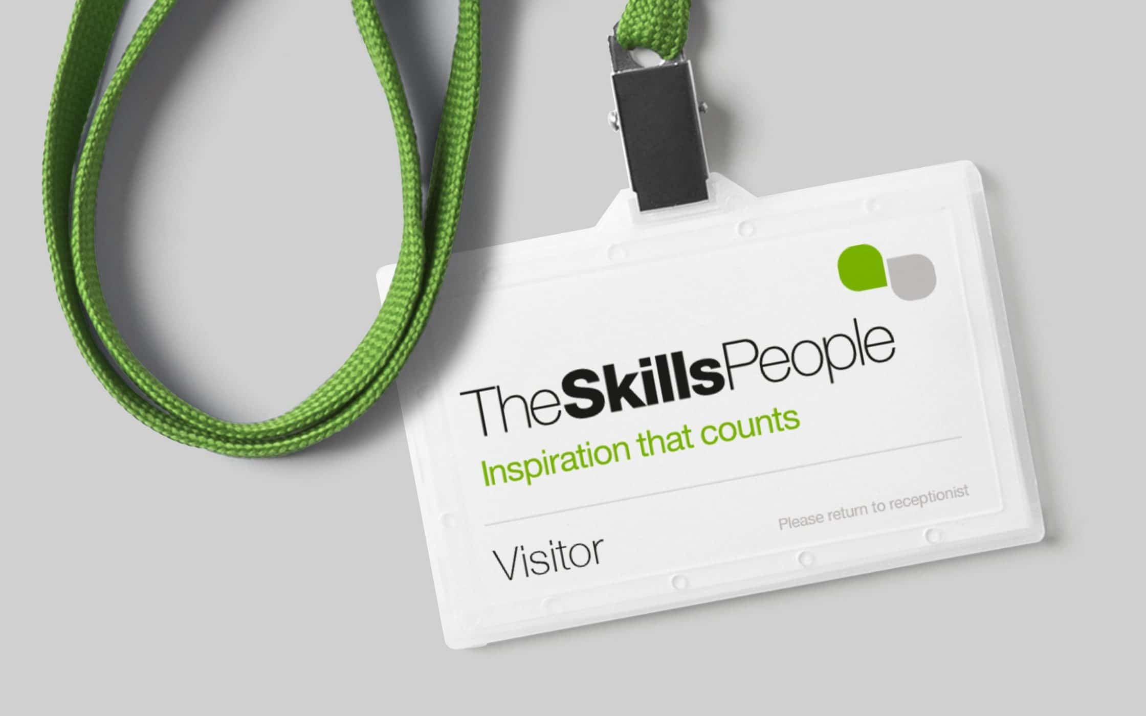 Close up of The Skills People lanyard carriage with a visitor card inside.