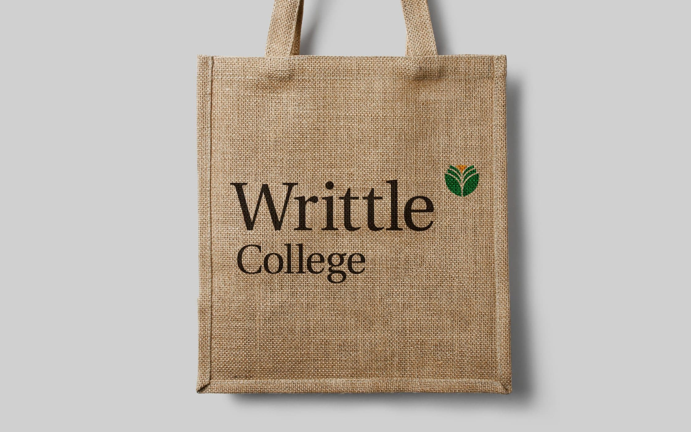 Woven material bag with Writtle College typeface and logo on.